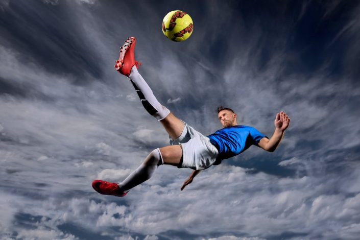 Soccer Player Doing A Bicycle Kick With Soccer Ball