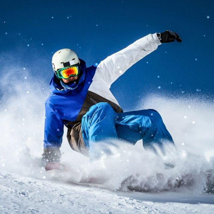 Snowboarder in Sudden Stop Skidding Motion